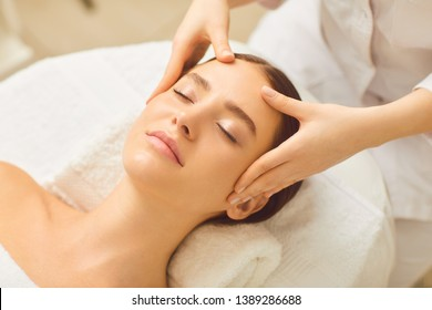 Beautiful girl has a facial massage in a beauty clinic.