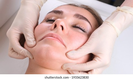 Beautiful girl has a facial massage in a beauty clinic. concept skin care, spa concept, treatment, facial massage.