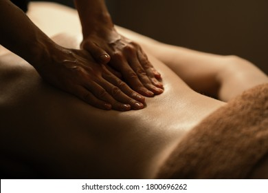 The beautiful girl has massage. Authentic image of luxury spa treatment. Warm colors, charming light. - Shutterstock ID 1800696262