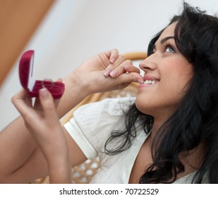 Beautiful girl has a ring as a gift