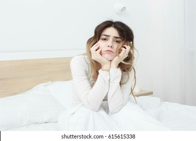 beautiful girl has woken up in the morning in bed in a bad mood.