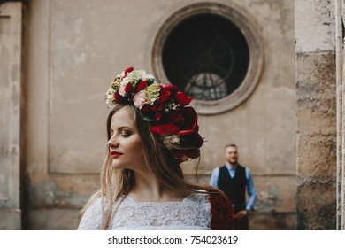 The beautiful girl has a wreath with flowers