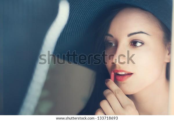 beautiful girl in a hat lipstick