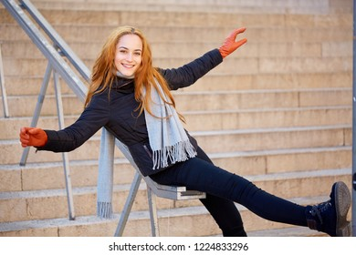 Beautiful girl have fun in winter on a handrail