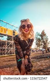 Beautiful girl having fun at festival