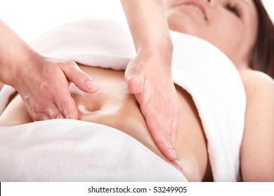 Beautiful  girl having stomach massage. Body care.