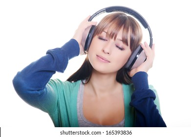 Beautiful girl in headphones over white background