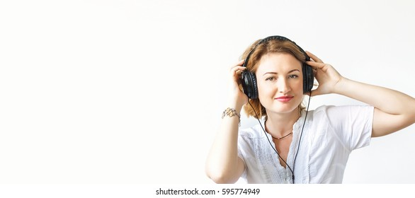 Beautiful girl in headphones, soft focus, on white background