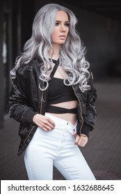 Beautiful girl with healthy long grey hair outdoor