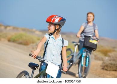 Beautiful girl and her grandmother on bikes. Lanzarote