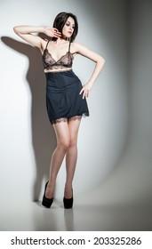 Beautiful girl in her underwear in studio