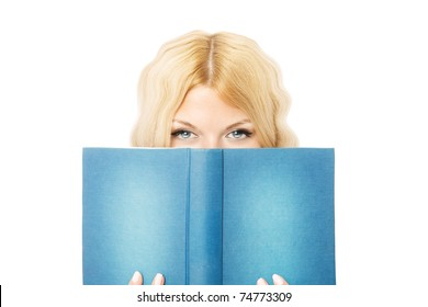 beautiful girl hiding herself behind a book