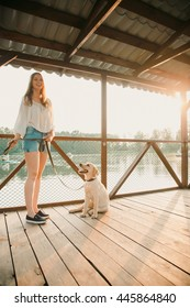 A beautiful girl and his dog