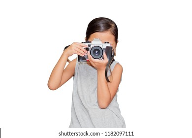 Beautiful girl holding a camera. (clipping path)
