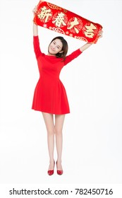 beautiful girl holding up couplet celebrating chinese new year,word meaning is blessing good luck.