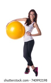 Beautiful girl holding inflatable fitness ball, looking at camera smiling, standing isolated on white background