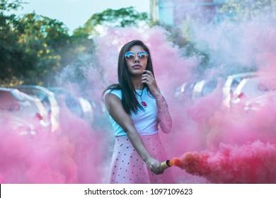 beautiful girl holding a ink smoke bomb.
