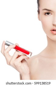 Beautiful girl holding liquid red lipstick container tube on white background
