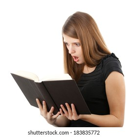 Beautiful girl holding and reading her book, studio shot on white background