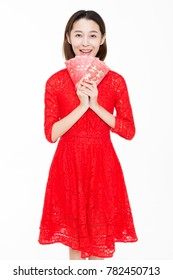 beautiful girl holding red envelope happily,white background,studio shot.