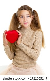 Beautiful girl holding red heart