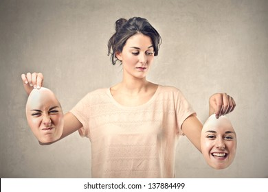 beautiful girl holds two masks