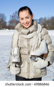 Beautiful girl with ice skates