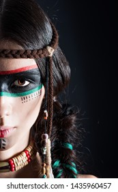 Beautiful girl in the image of fashion beauty Indian Apaches. Battle rasras indians