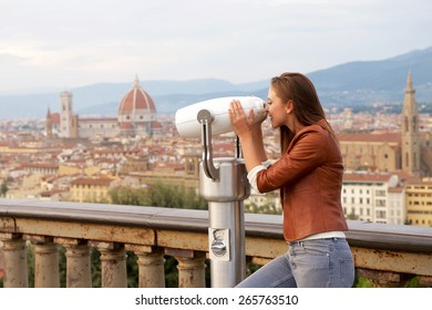 Beautiful girl impressed view the panorama of Florence at sunset