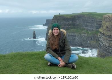 Beautiful girl in Ireland on a journey at the Irish west coast