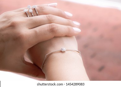Beautiful girl with jewelry . A set of jewelry for woman ,necklace ,earrings and bracelet. Beauty and accessories / Beautiful woman with stylish jewelry closeup /