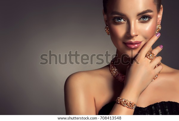 Beautiful girl with jewelry . A set of jewelry for woman ,necklace ,earrings and bracelet. Beauty and accessories.  bijouterie