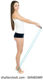 the beautiful girl with a jump rope was photographed in studio on a white background