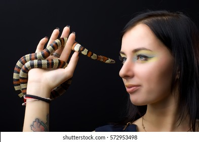 Beautiful girl and king milk snake in the studio