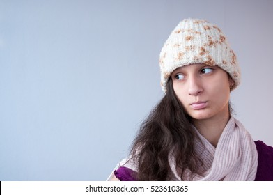 Beautiful girl in knitted hat and scarf