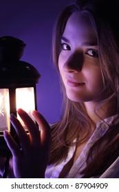 beautiful girl with lantern seeking in night
