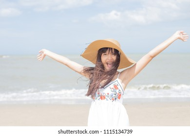 Beautiful girl laughing happily on a sunny day, Hua Hin, Thailand