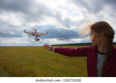 beautiful girl launch a copter into the sky