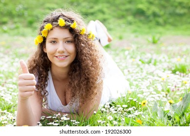 beautiful girl laying on flowers field,outdoor portrait summer