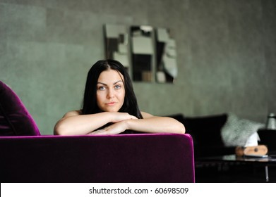 The beautiful girl lays on a sofa in a room