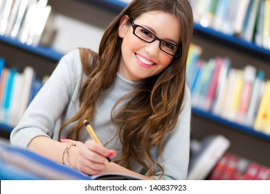 Beautiful girl in a library