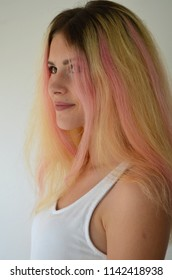 Beautiful girl with light long hair, painted in ombre with pink locks