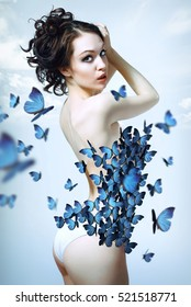 beautiful girl in lingerie with butterflies on sky background