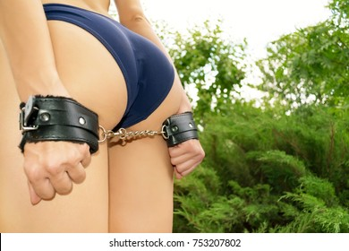 Beautiful girl in lingerie is handcuffed. Concept against women's violence