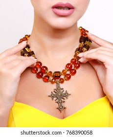 beautiful girl with beautiful lips dressed in yellow dress and beautiful luxurious handmade necklace accessories