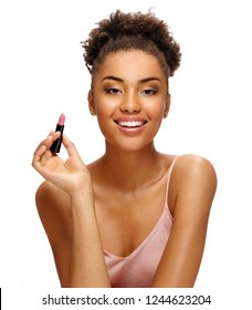 Beautiful girl with lipstick. Photo of african american girl with perfect skin on white background. Skin care and beauty