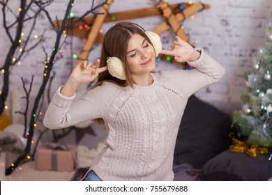 Beautiful girl listens to music and enjoys