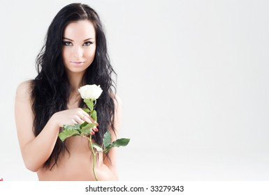 Beautiful girl with long black hair and white rose