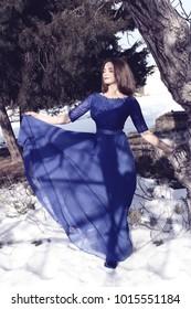 Beautiful girl in a long blue dress.