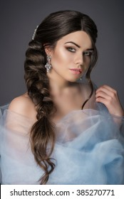 Beautiful girl with long brown hair. The girl with the wedding hair and makeup